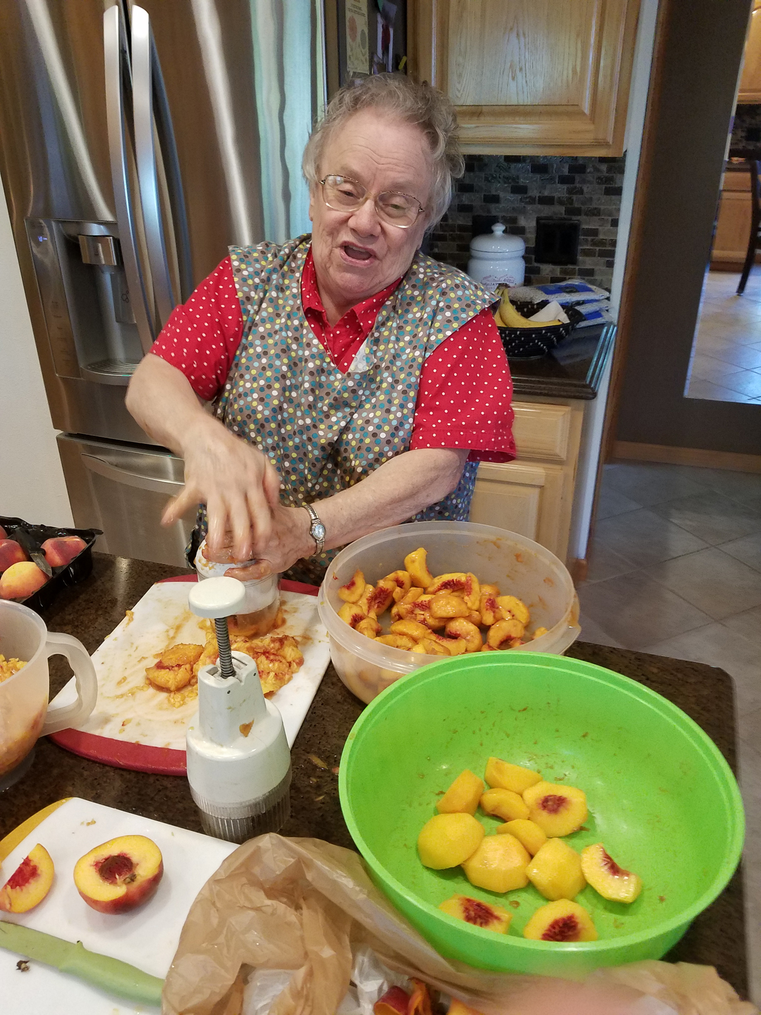 Sister Pauline makes peach jam for the Christmas Bazaar